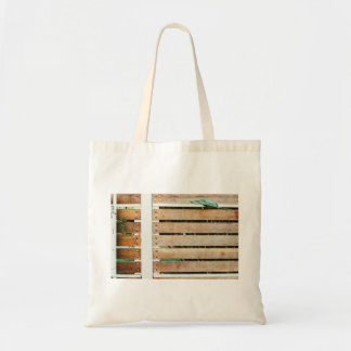 Garden guarded by wooden fence budget tote bag