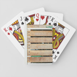 Garden guarded by wooden fence card deck