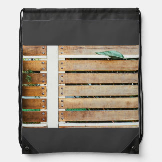 Garden guarded by wooden fence cinch bag