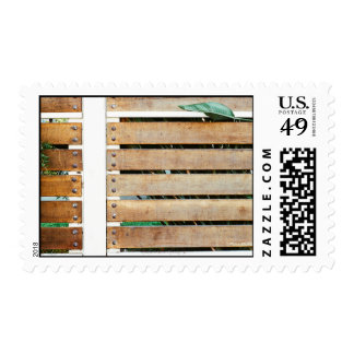 Garden guarded by wooden fence postage stamps