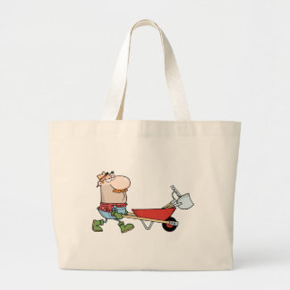 Gardener Drives A Barrow With Tools Bags