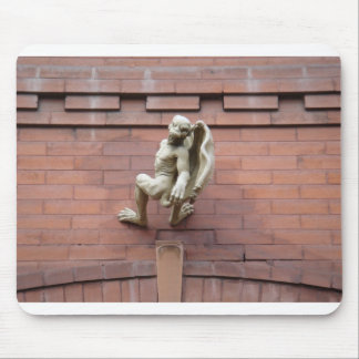 Gargoyle Hanging on  Red Brick Wall Mouse Pad