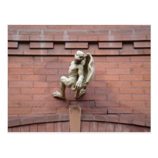 Gargoyle Hanging on  Red Brick Wall Post Card