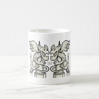Gargoyles on spires.  Cup mug.