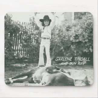 Garlene Tindall standing on a trick horse. Mouse Pad