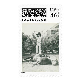 Garlene Tindall standing on a trick horse Postage