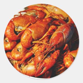 Garras de los cangrejos pegatina redonda