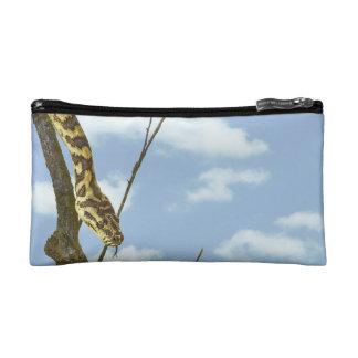 Garter Snake on a Limb against a Blue Sky Cosmetic Bag
