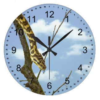 Garter Snake on a Limb against a Blue Sky Large Clock