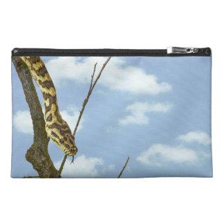 Garter Snake on a Limb against a Blue Sky Travel Accessories Bags