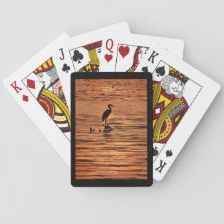 Garza en la puesta del sol barajas de cartas