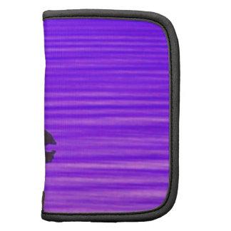 Garza en un lago púrpura planificador