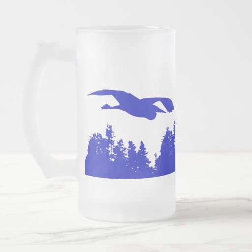 Garzas de gran azul en taza azul