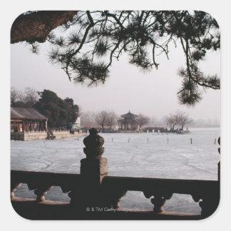 Gate and foliage by frozen lake, China Square Sticker