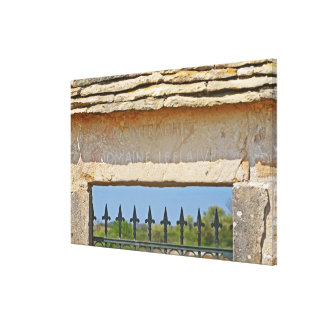 Gate and key stone carved with Montrachet, Canvas Print