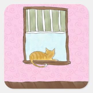 Gatito amarillo en pegatinas de una ventana