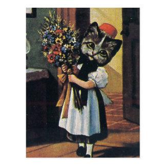 Gatito de la niña con las flores tarjeta postal
