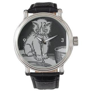 Gatito del gato que consiguió el ejemplo poner relojes