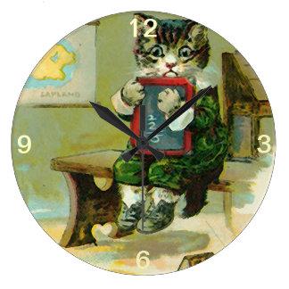 Gatito del vintage castigado en la escuela reloj de pared