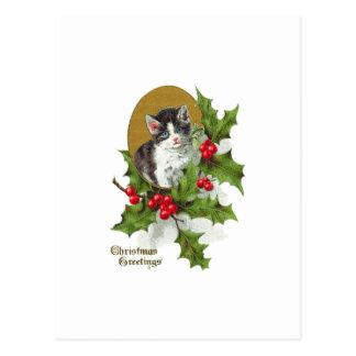 Gatito en el navidad del vintage del acebo postal