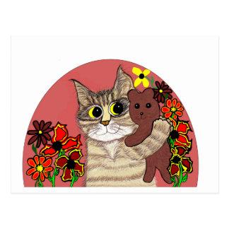 gatito lindo del dibujo animado que sostiene teddy tarjeta postal