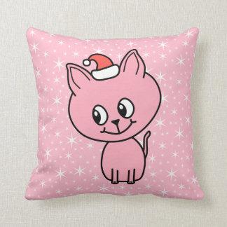 Gatito rosado lindo en un sombrero del navidad cojines