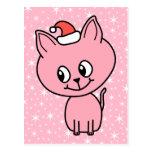 Gatito rosado lindo en un sombrero del navidad postal