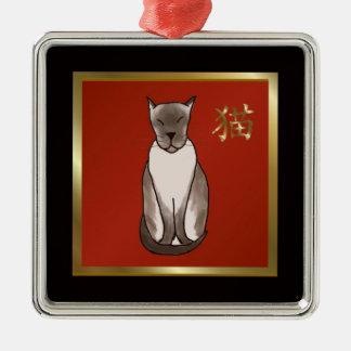 Gatito siamés con rojo y el ornamento del oro adornos de navidad