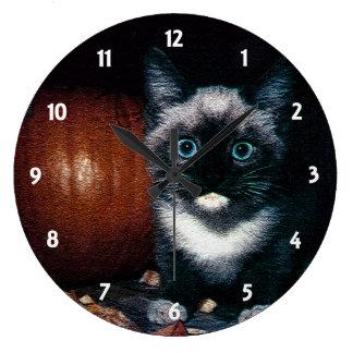 Gatito y calabaza para Halloween Reloj