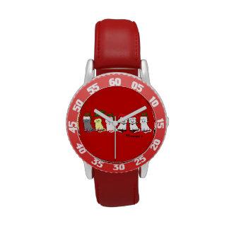 Gatitos del navidad en un reloj de los niños rojos