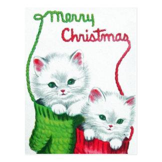 Gatitos en Felices Navidad de las manoplas Postales