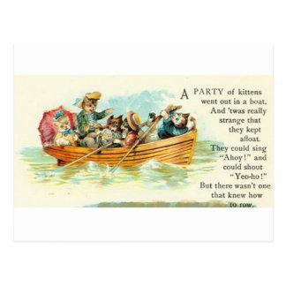 Gatitos en un barco de fila postales