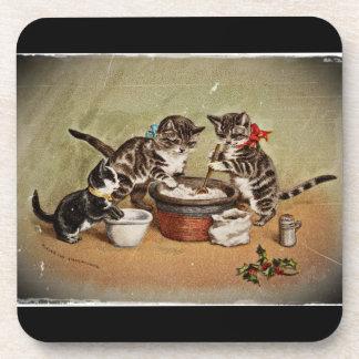Gatitos que hacen el pudín del navidad posavaso