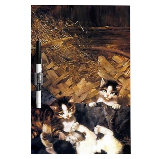 Gatitos que juegan en una cesta pizarras