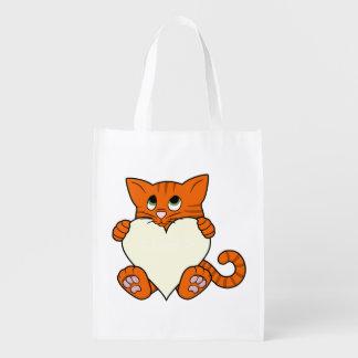 Gato anaranjado del el día de San Valentín con el Bolsa Para La Compra
