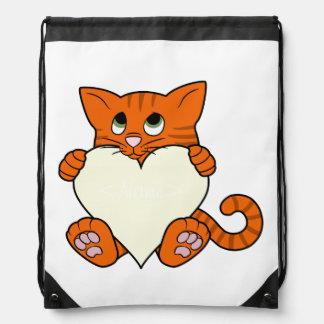 Gato anaranjado del el día de San Valentín con el Mochila