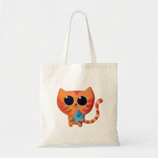Gato anaranjado lindo con la estrella bolsa