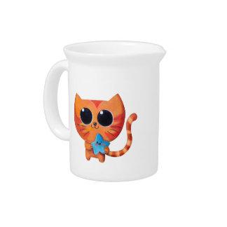 Gato anaranjado lindo con la estrella jarras