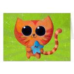 Gato anaranjado lindo con la estrella tarjeta