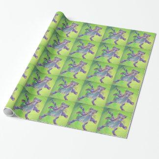 gato azul del ataque del vuelo en verde papel de regalo