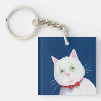 Gato blanco con el arco rojo - llavero de acrílico