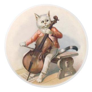 Gato blanco que juega el botón decorativo del pomo de cerámica