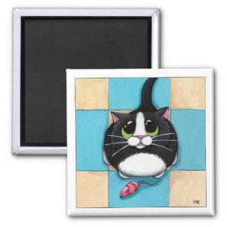 Gato con el imán del ratón del juguete