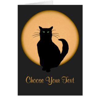 Gato contra la tarjeta de levantamiento de la luna