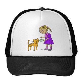 Gato de alimentación del chica gorras de camionero