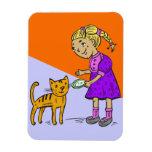 Gato de alimentación del chica iman