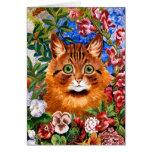 Gato de Brown entre la tarjeta de las flores