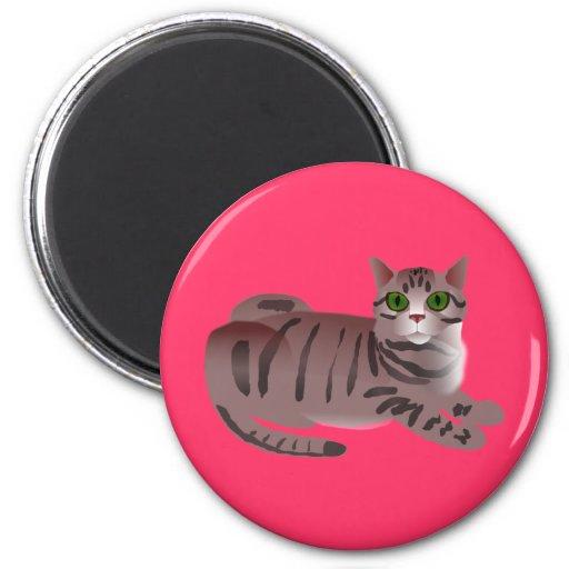 Gato de ojos verdes del dibujo animado imán redondo 5 cm