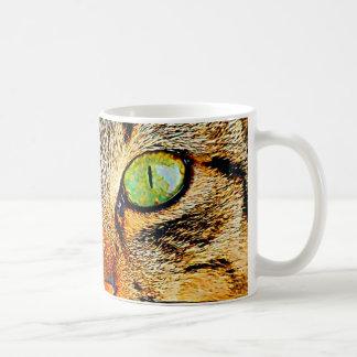 Gato de ojos verdes fascinador taza