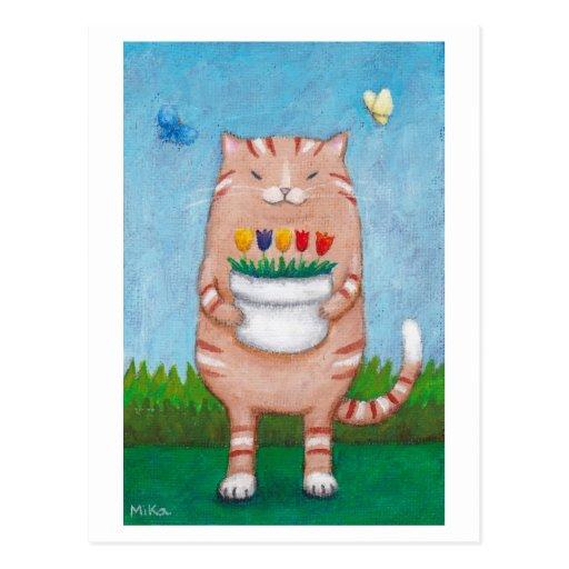Gato de Tabby anaranjado con la postal de las mari